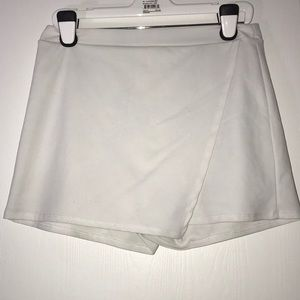 White strechy skirt with shorts underneath